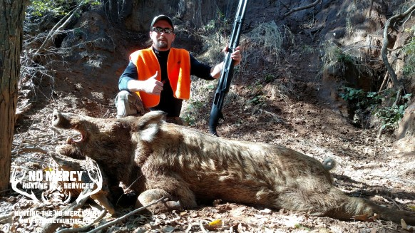 Another trophy hog taken at No Mercy Hunting Services!